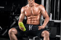 Young handsome guy doing exercises in the gym Royalty Free Stock Photography
