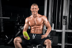 Young handsome guy doing exercises in the gym Stock Photography