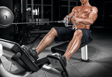 Young handsome guy doing exercises in the gym Stock Photo