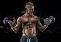 Young handsome guy doing exercises in the gym Royalty Free Stock Photo