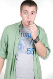 Young handsome guy eating a chocolate stick Stock Photo