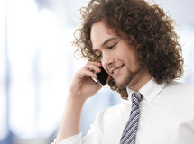Young handsome guy enjoying a telephonic conversation Stock Image