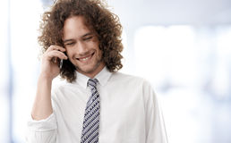 Young handsome guy enjoying a telephonic conversation Royalty Free Stock Photo