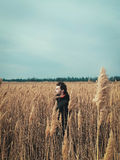 Young handsome guy in a field stock image