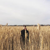 Young handsome guy in a field royalty free stock photography