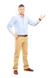Young handsome guy gesturing with his hand Royalty Free Stock Photos