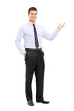 Young handsome guy gesturing with his hand Stock Images
