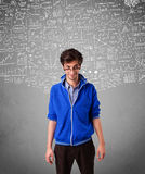 Young handsome guy with hand drawn calculations and icons Stock Images