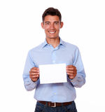 Young handsome guy holding blank card Royalty Free Stock Photo