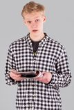 Young handsome guy with journal Royalty Free Stock Images