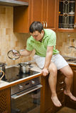 Young handsome guy in the kitchen Royalty Free Stock Image