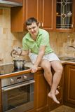 Young handsome guy in the kitchen Royalty Free Stock Photos