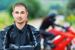 Young handsome guy motorcyclist Royalty Free Stock Photography