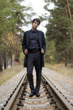 Young handsome guy on a rail road Stock Photos