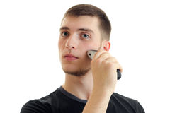 Young handsome guy shaves close-up face Royalty Free Stock Images
