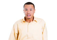 A young handsome  guy shocked and stunned mouth and eyes wide open Royalty Free Stock Photos