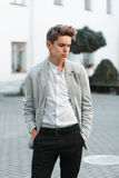 Young handsome guy in stylish clothes Royalty Free Stock Image
