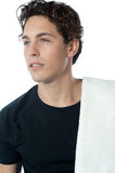 Young handsome guy with towel, closeup shot Royalty Free Stock Images