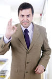 A young handsome happy business man gesturing success at office. Building Royalty Free Stock Images