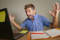 Young handsome and happy business man working with laptop computer at home office gesturing cheerful and excited in entrepreneur s royalty free stock photo