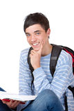 Young handsome happy male student with book Royalty Free Stock Photography