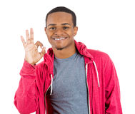 Young handsome happy smiling man giving OK sign Stock Photo