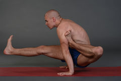 Young handsome healthy yoga man instructor doing yoga in photo studio. Stock Images