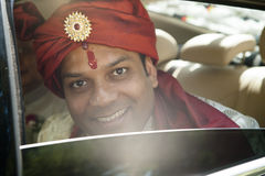 Young handsome Hindu groom looking out the window Stock Photography