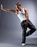 Young handsome hip hop dancer posing in studio Royalty Free Stock Photography