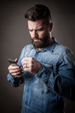 Young handsome hipster with beard Royalty Free Stock Photos