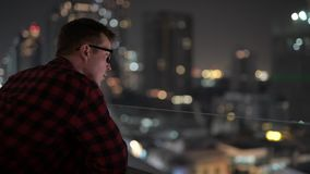 Young Handsome Hipster Man Looking At View Of The City At Night stock video
