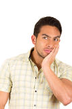 Young handsome hispanic man expressing amazement Royalty Free Stock Photos