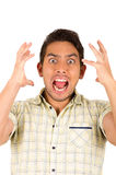 Young handsome hispanic man expressing shock Stock Photo
