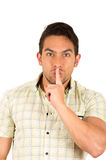 Young handsome hispanic man gesturing a secret Royalty Free Stock Photo