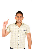 Young handsome hispanic man pointing up Stock Photo