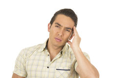 Young handsome hispanic man posing with headache Royalty Free Stock Image