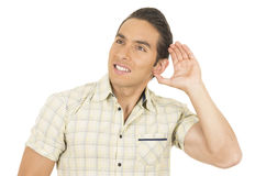 Young handsome hispanic man posing listening Stock Photo