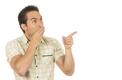 Young handsome hispanic man posing pointing at Royalty Free Stock Photos