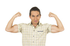 Young handsome hispanic man posing showing arm Royalty Free Stock Photography
