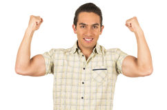 Young handsome hispanic man posing showing arm Royalty Free Stock Image