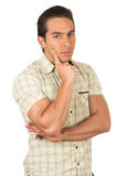 Young handsome hispanic man posing thinking. Arms crossed isolated on white Stock Photography