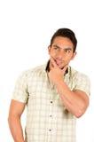 Young handsome hispanic man thinking Stock Photo