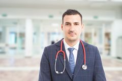 Young handsome hospital manager with stethoscope royalty free stock photography