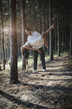 Young handsome Indian couple dancing in forest wearing white Royalty Free Stock Photos