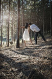 Young handsome Indian couple flirting in forest wearing white Stock Image