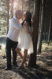 Young handsome Indian couple kissing in forest Stock Photos