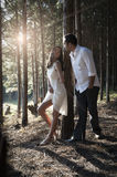 Young handsome Indian couple spending a romantic afternoon in forest Stock Image
