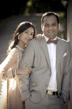 Young handsome Indian couple standing together outdoors. In formal attire Royalty Free Stock Photo