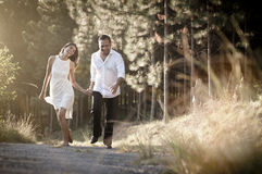 Young handsome Indian couple walking through field Stock Photography
