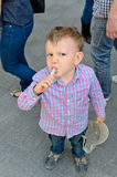 Young handsome little boy eating a treat Royalty Free Stock Images